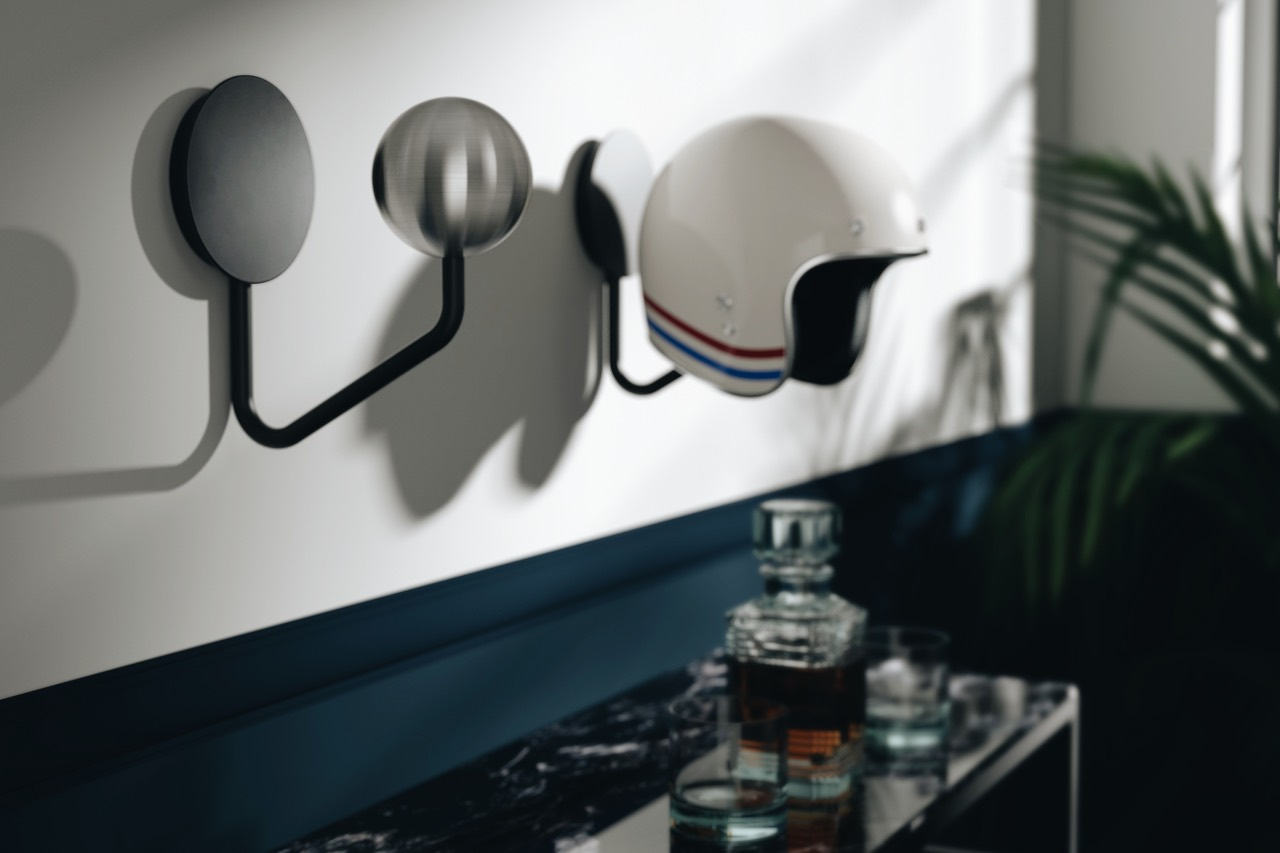 Halley Wall Rack with Bell 500 Custom Open Face Helmet against white wall