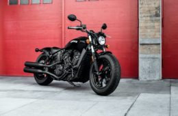 Scout Bobber Sixty - Indian Motorcycle with red door background