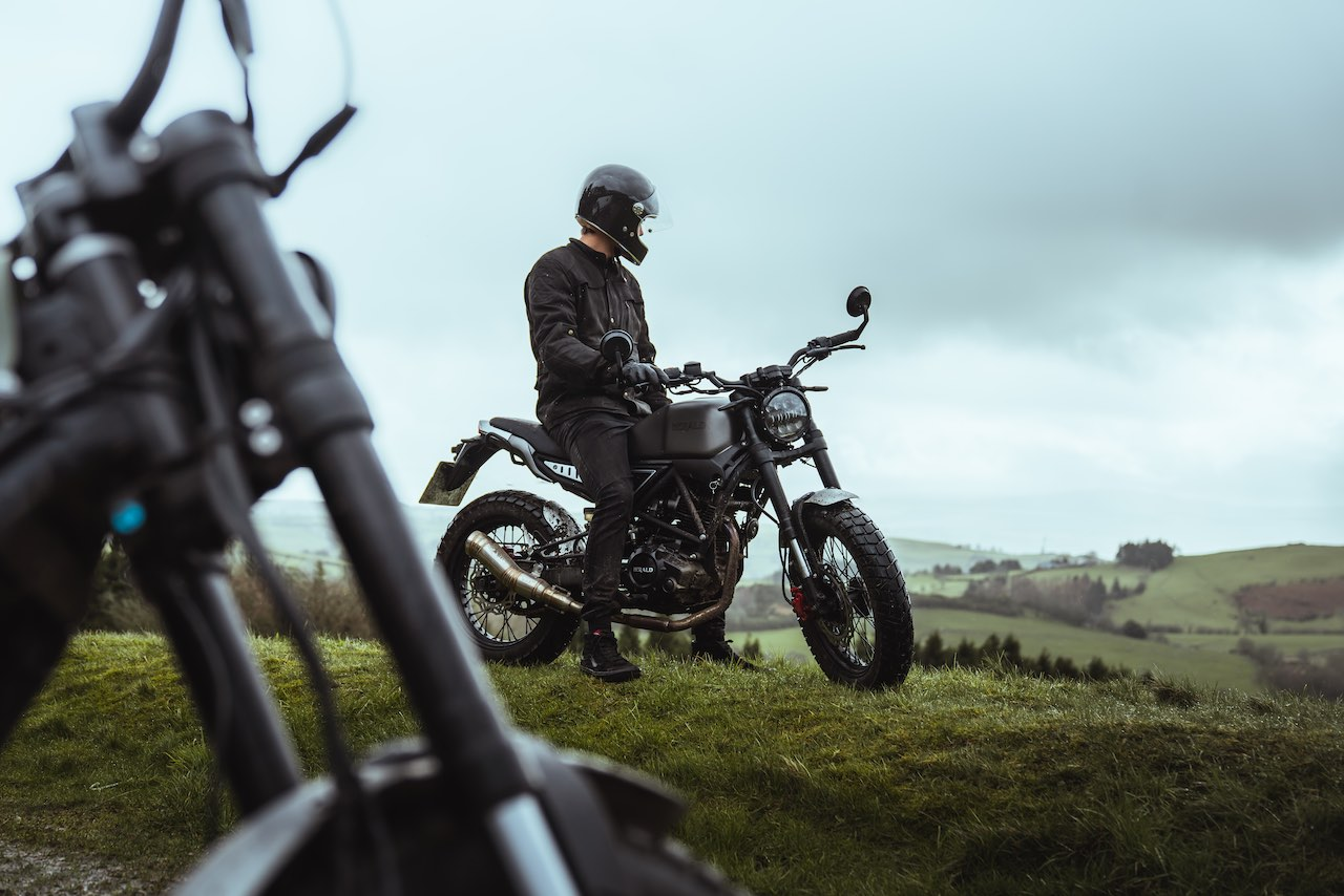 Rider in Wales sitting on Herald Motor Co. Brat 125